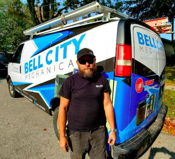 Image of man in front of work van